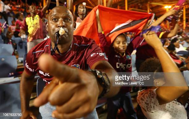 West Indies fan cheers on his team during the ICC Women's World T20 2018 match between West Indies and South Africa at Darren Sammy Cricket Ground on...