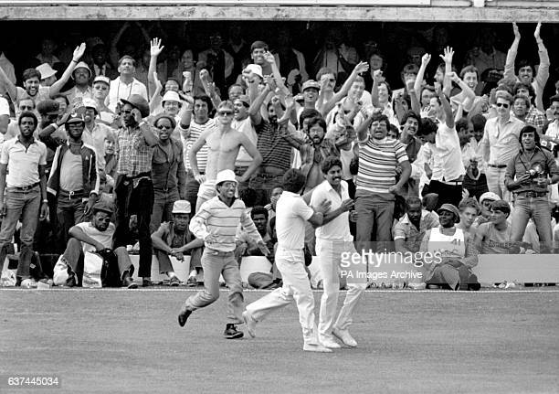 West Indies fans show their dejection as an India fan runs onto the pitch to congratulate India captain Kapil Dev on dismissing West Indies captain...