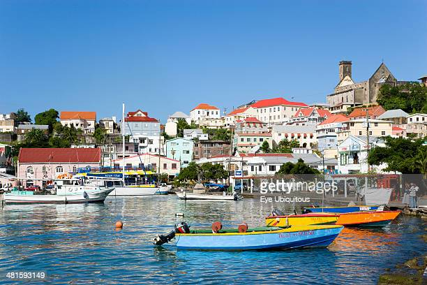 West Indies Grenada St George Water taxi boats moored in the Carenage harbor of the capital city of St George's with houses and the roofless...