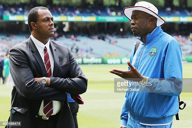 West Indies head coach Curtly Ambrose talks with Courtney Walsh during day one of the Second Test match between Australia and the West Indies at...