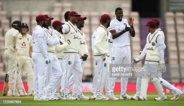 West Indies' Jason Holder celebrates taking the wicket of England's Jofra Archer on the second day of the first Test cricket match between England...