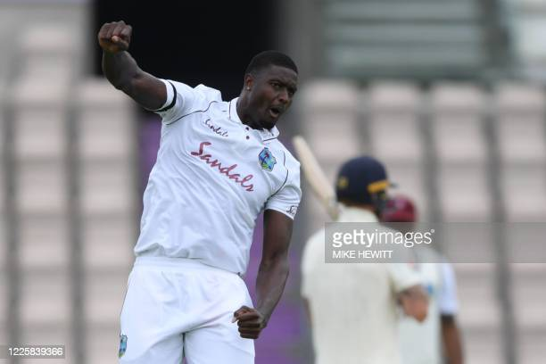 West Indies' Jason Holder celebrates taking the wicket of England's Zak Crawley on the second day of the first Test cricket match between England and...