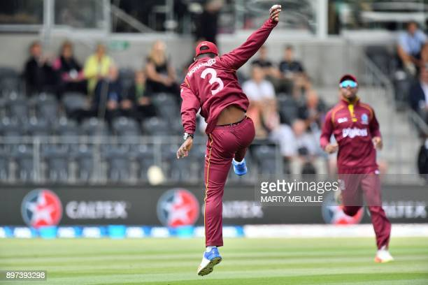 West Indies Jason Mohammed celebrates catching New Zealand's Colin Munro watched by teammate Shimron Hetmyer during the second One Day International...