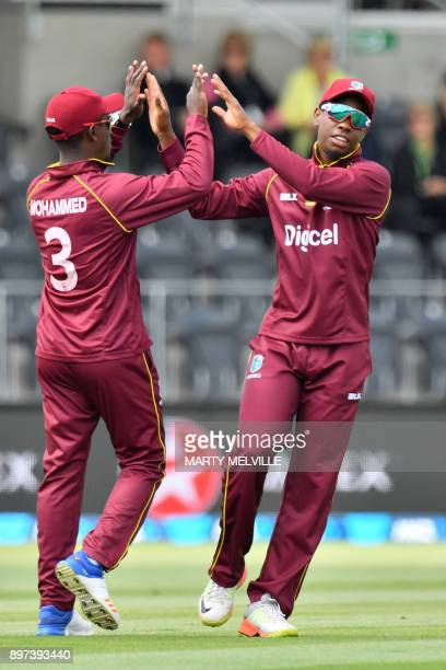 West Indies Jason Mohammed celebrates catching New Zealand's Colin Munro with team mate Shimron Hetmyer during the second One Day International...