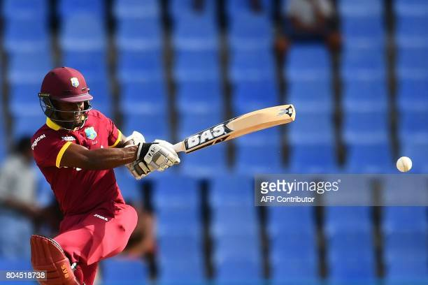 TOPSHOT West Indies' Jason Mohammed plays a shot during the third One Day International match between West Indies and India at the Sir Vivian...