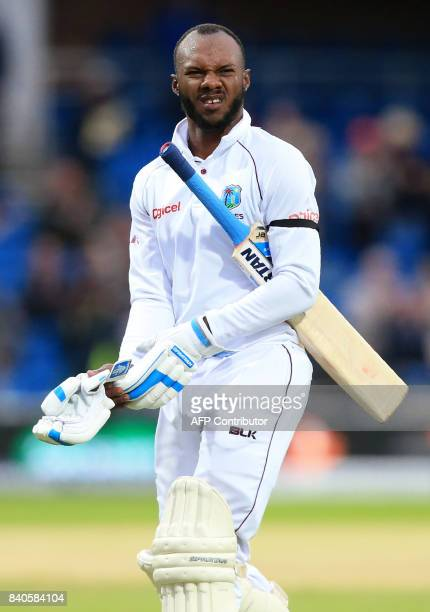 West Indies' Jermaine Blackwood walks back to the pavilion after losing his wicket for 41 runs on the fifth day of the second international Test...