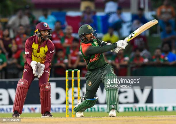 West Indies keeper Denesh Ramdin watches Liton Das of Bangladesh hits 6 during the 3rd and final T20i match between West Indies and Bangladesh at...