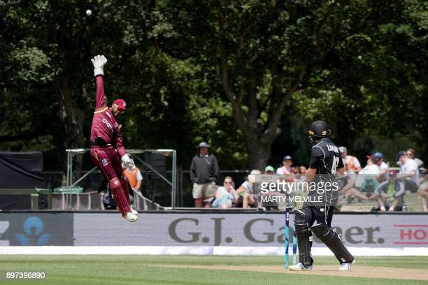 West Indies keeper Shai Hope attempts to catch New Zealand's Tom Latham during the second One Day International cricket match between New Zealand and...
