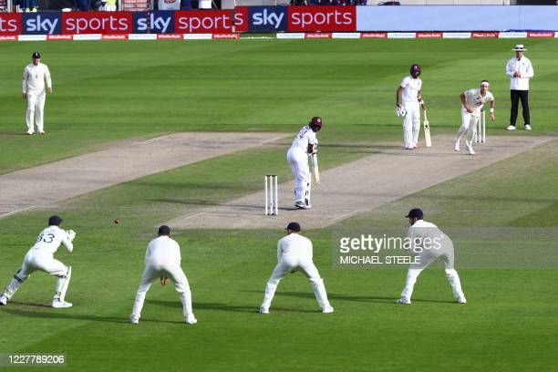 West Indies' Kemar Roach looks behind as England's Jos Buttler catches his out off the bowling of England's Stuart Broad on the third day of the...