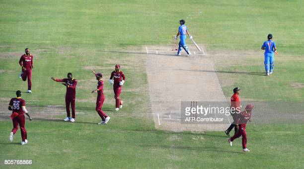 West Indies' Kesrick Williams celebrates after dismissing India's MS Dhoni during the fourth One Day International match between West Indies and...