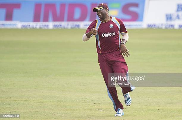 West Indies' Kieron Pollard celebrates after catching the gal to out Bangladesh batsman Nasir Hossain during the second One Day International between...