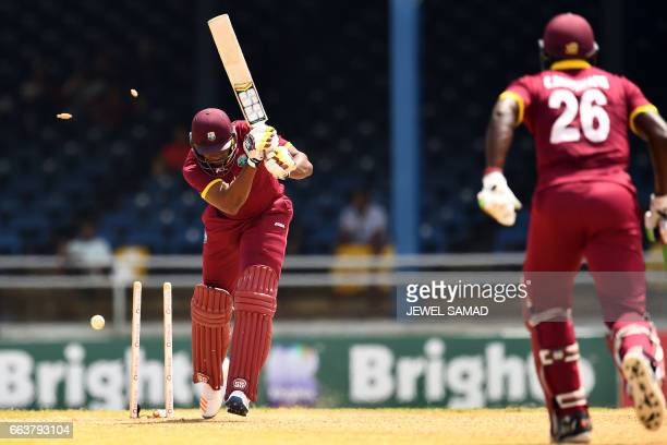 West Indies' Kieron Pollard is bowled off Pakistan's Rumman Raees during the final of fourT20Imatch between West Indies and Pakistan at the Queens...