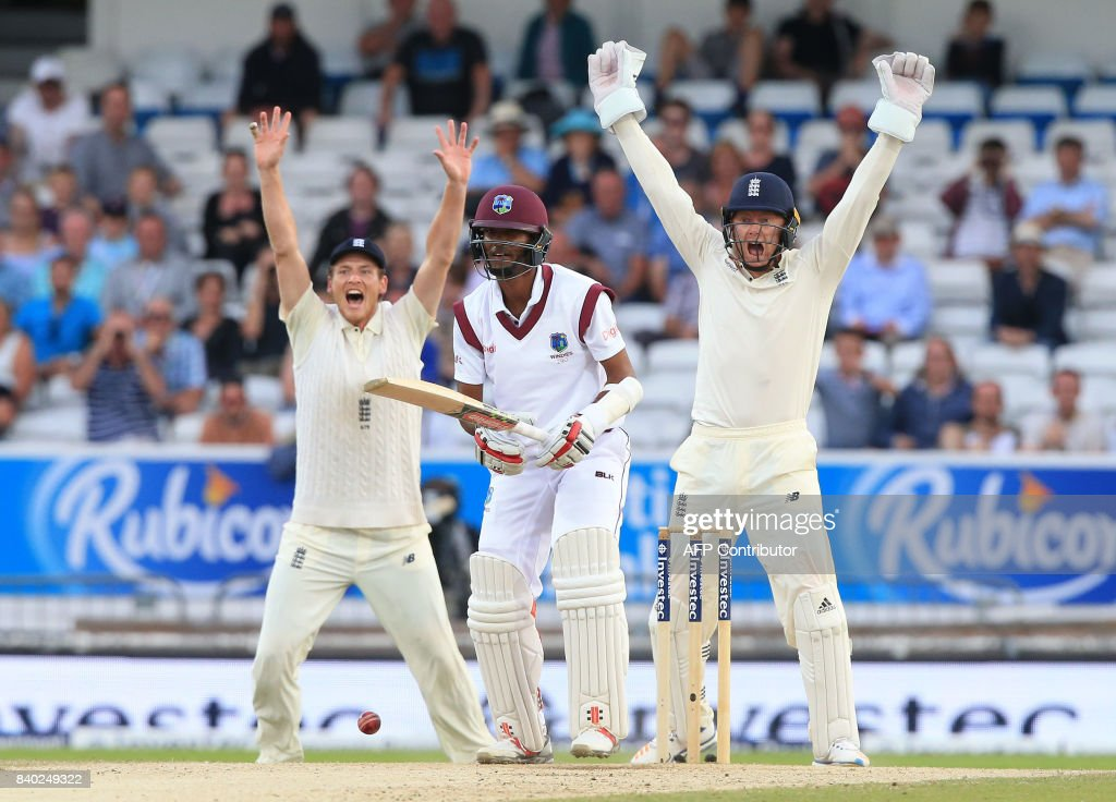 West Indies' Kraigg Brathwaite (C) bats on the fourth day of the second international Test match between England and the West Indies at Headingley cricket ground in Leeds, northern England, August 28, 2017. / AFP PHOTO / Lindsey Parnaby / RESTRICTED