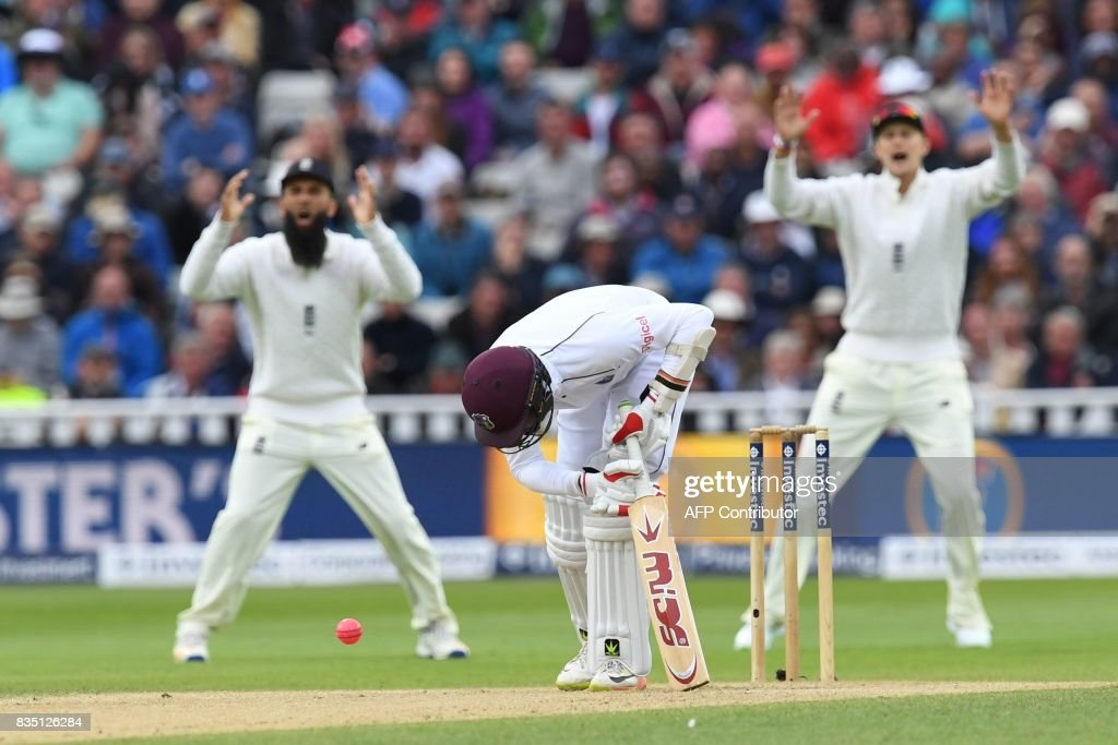 West Indies' Kyle Hope is hit by a short ball during play on day 2 of the first Test cricket match between England and the West Indies at Edgbaston in Birmingham, central England on August 18, 2017. / AFP PHOTO / Paul ELLIS / RESTRICTED
