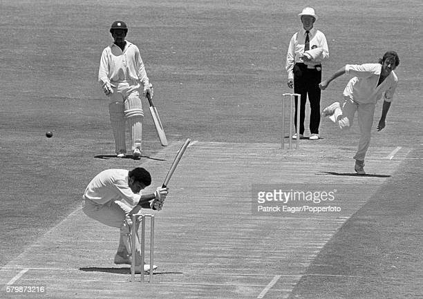 West Indies opening batsman Bernard Julien ducks a bouncer from Dennis Lillee of Australia watched by fellow opener Roy Fredericks during the 2nd...