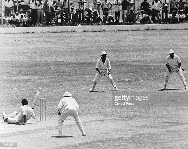 West Indies opening batsman Steve Camacho slips after ducking under a bouncer from England bowler David Brown during the West Indies' first innings...