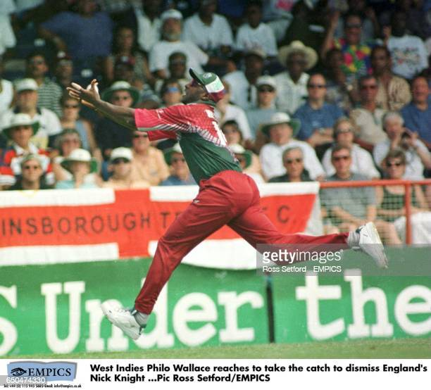 West Indies' Philo Wallace reaches to take the catch to dismiss England's Nick Knight