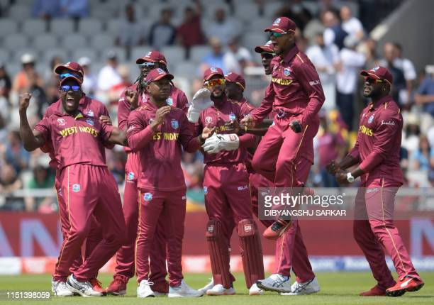 West Indies players celebrate after the dismissal of New Zealand's Martin Guptill during the 2019 Cricket World Cup group stage match between West...