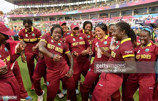 West Indies players celebrate after winning the World T20 cricket tournament women's final match between Australia and West Indies at The Eden...