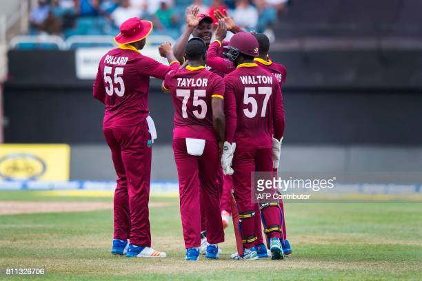 West Indies' players celebrate catching out India's captain Virat Kohli during the T20 match between West Indies and India at the Sabina Park Cricket...