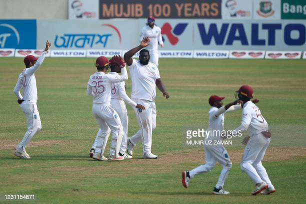 West Indies players celebrate the dismissal of Bangladesh's Najmul Hossain Shanto during the fourth day of the second Test cricket match between West...