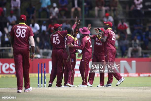 West Indies players celebrate the wicket of Michael Jones of Scotland during The ICC Cricket World Cup Qualifier between the West Indies and Scotland...