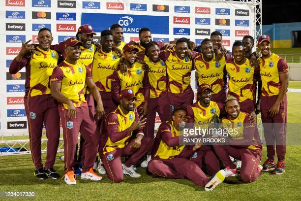West Indies players celebrate with the winning trophy at the end of the 5th and final T20I between Australia and West Indies at Darren Sammy Cricket...