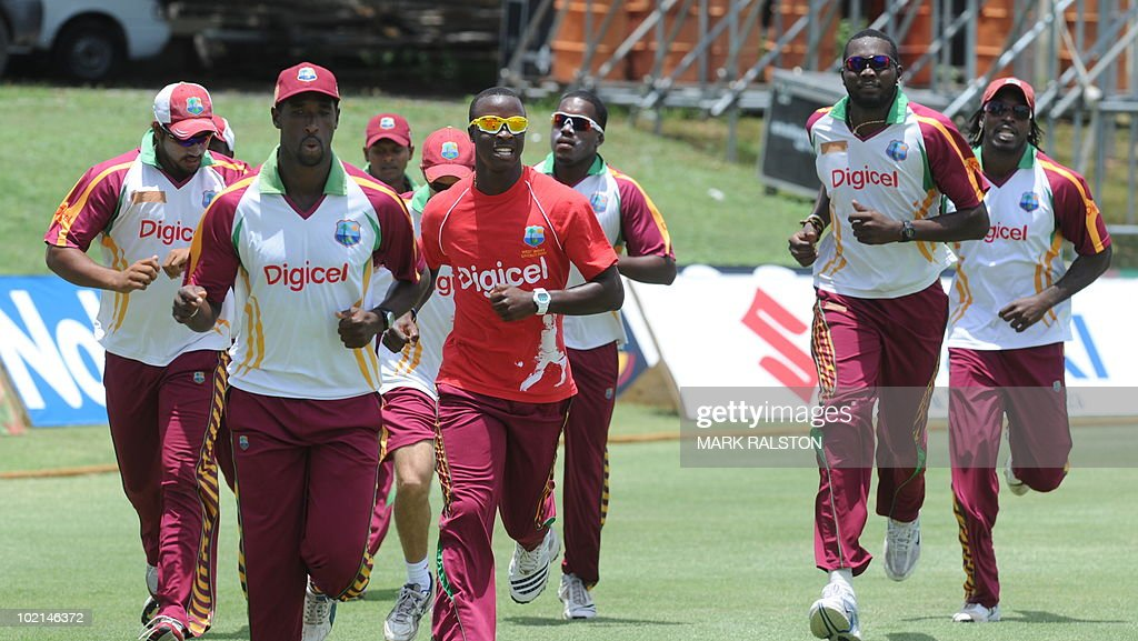 West Indies players jog as they warm-up during a training session before the second test at the Warner Park ground in the St Kitts capital of Basseterre on June 16, 2010. South Africa have taken a 1-0 lead in the three-Test series, with the second test beginning on June 18. AFP PHOTO/Mark RALSTON