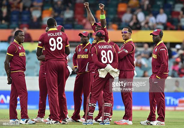 West Indies players led by West Indies Darren Sammy celebrate the wicket of unseen Zimbabwe batsman Regis Chakabva during the 2015 Cricket World Cup...