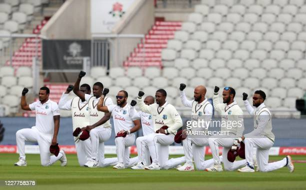 West Indies players 'take a knee' in support of the Black Lives Matter movement prior to the start of the third Test cricket match between England...