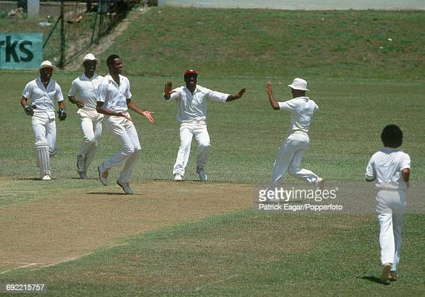 West Indies players Thelston Payne, Richie Richardson, Courtney Walsh, Viv Richards, Carlisle Best and Larry Gomes celebrate a wicket during the 2nd...