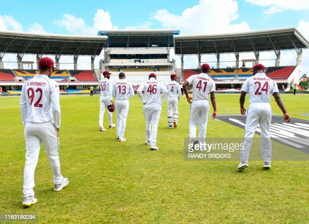 West Indies players walk onto the field at the start of day 1 of the 1st Test between West Indies and India at Vivian Richards Cricket Stadium in...