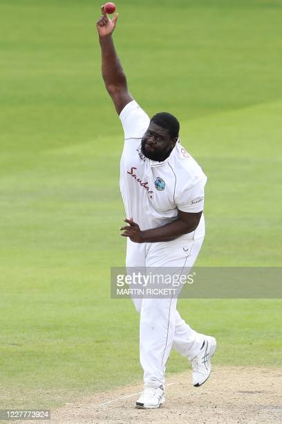 West Indies' Rahkeem Cornwall bowls on the second day of the third Test cricket match between England and the West Indies at Old Trafford in...