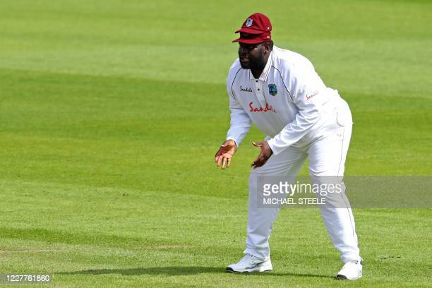 West Indies' Rahkeem Cornwall fields in the slips wearing two caps during play on the first day of the third Test cricket match between England and...