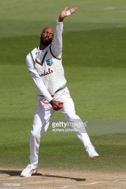 West Indies' Roston Chase bowls on the fourth day of the first Test cricket match between England and the West Indies at the Ageas Bowl in...