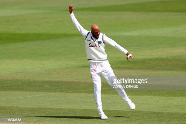 West Indies' Roston Chase celebrates after taking the wicket of England's Joe Denly for 29 on the fourth day of the first Test cricket match between...
