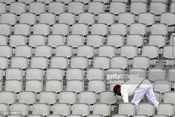 West Indies' Roston Chase has to go into the stands to retrieve the ball hit for six by England's Ben Stokes on the final day of the second Test...