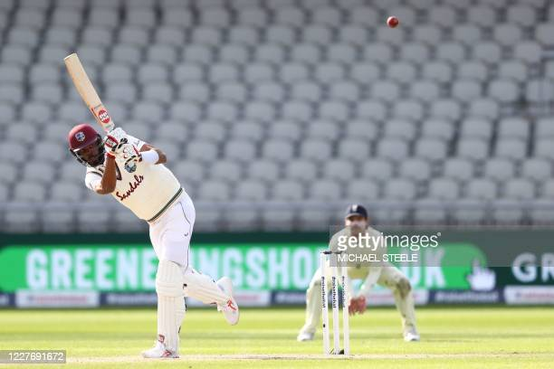 West Indies' Roston Chase hits a boundary on the fourth day of the second Test cricket match between England and the West Indies at Old Trafford in...