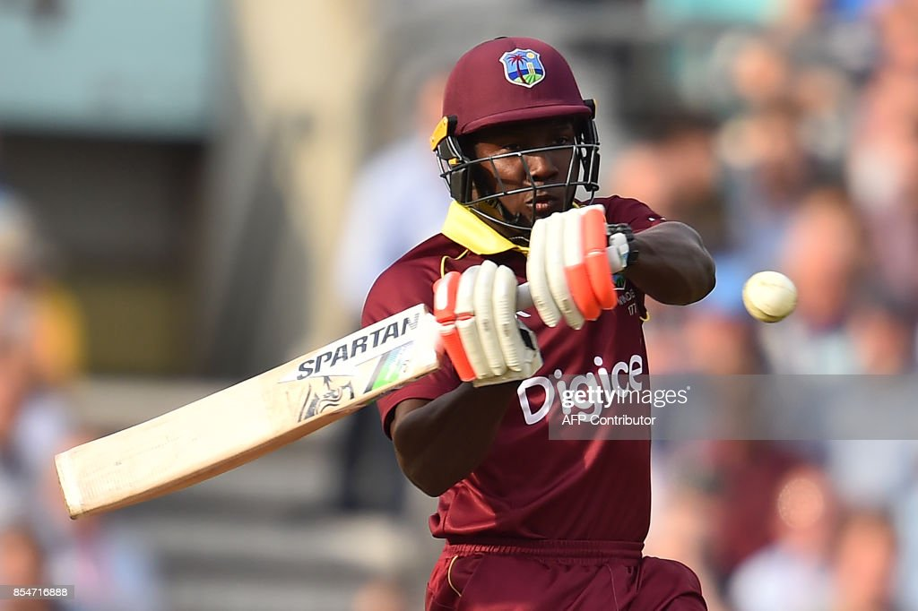 West Indies' Rovman Powell plays a shot during the fourth One-Day International (ODI) cricket match between England and the West Indies at the Oval in London on September 27, 2017. / AFP PHOTO / Glyn KIRK / RESTRICTED