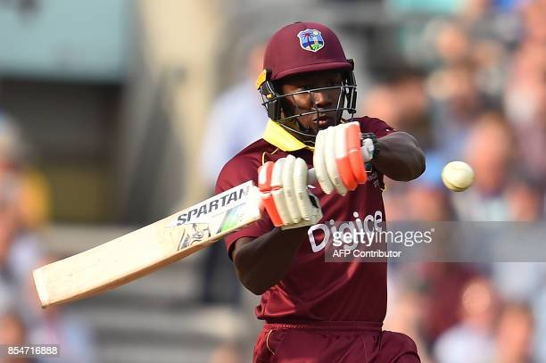 West Indies' Rovman Powell plays a shot during the fourth OneDay International cricket match between England and the West Indies at the Oval in...