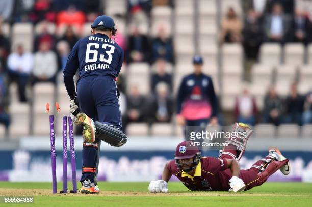 West Indies' Shai Hope makes the crease to avoid a runout by England's Jos Buttler during the final OneDay International cricket match between...