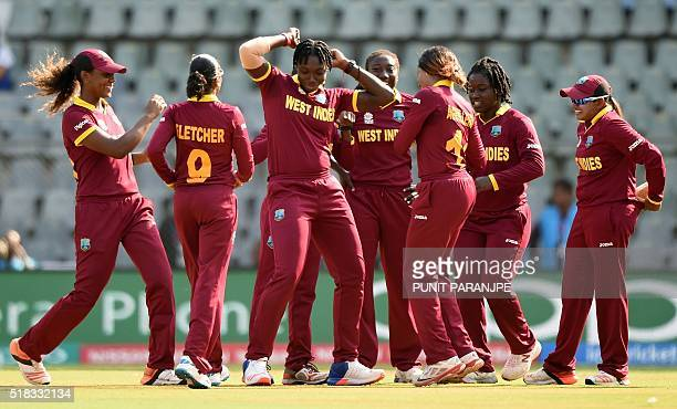 West Indies Shamilia Connell celebrates with teammates after taking the wicket of New Zealand batsman Rachel Priest during the World T20 women's...