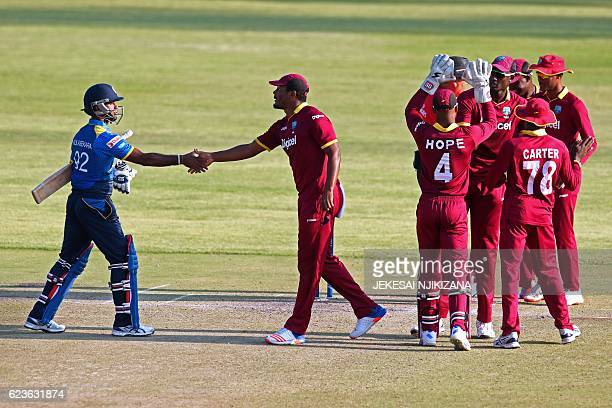 West Indies Shannon Gabriel shakes hands with Sri Lanka batsman Nuwan Kulasekara after defeating Sri Lanka during the second One Day International...