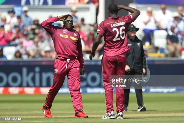 West Indies' Sheldon Cottrell and Carlos Brathwaite salute each other after running out Sri Lanka's Kusal Perera during the ICC Cricket World Cup...