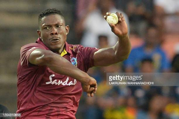 West Indies Sheldon Cottrell delivers a ball during the third one day international cricket match between Sri Lanka and West Indies at the Pallekele...