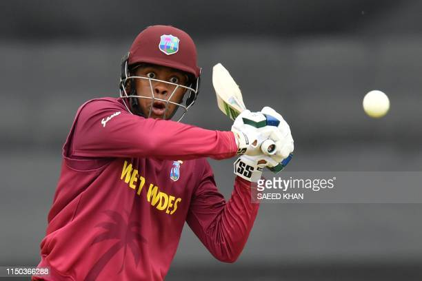 West Indies' Shimron Hetmyer hits the ball for 6 runs during the 2019 Cricket World Cup group stage match between West Indies and Bangladesh at The...