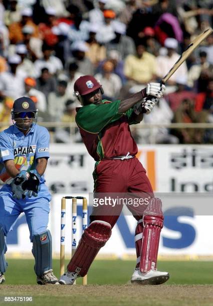 West Indies skipper Carl Hooper hits a ball during the 6th oneday International cricket match against India at Barkatullah Khan cricket stadium in...
