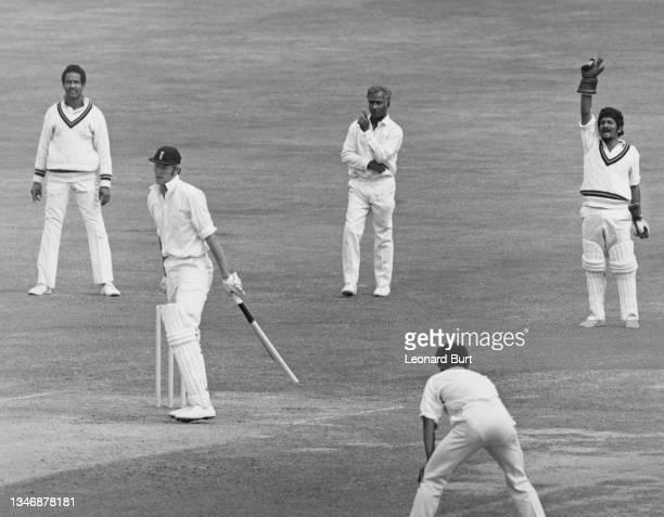 West Indies slip fielders Garfield Sobers and Rohan Kanhai look on as wicketkeeper Deryck Murray raises his arm in appeal as England captain Tony...