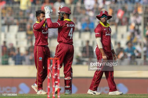 West Indies spiner Devendra Bishoo celebrate with Shai Hope after the dismissal of Bangladesh's Tamim Iqbal during the second ODI match between...