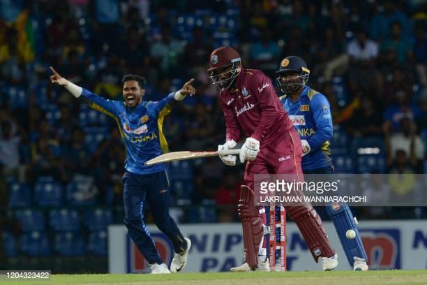 West Indies Sunil Ambris gets dismissed by Sri Lanka's Wanindu Hasaranga during the third one day international cricket match between Sri Lanka and...